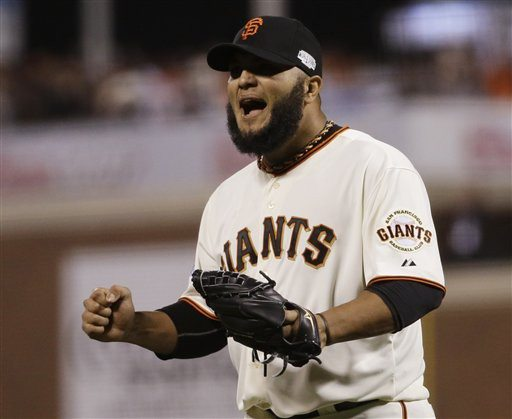 Matt Slocum/APGiants reliever Yusmeiro Petit is pumped after retiring the Royals in the sixth inning of Game 4 of the World Series.