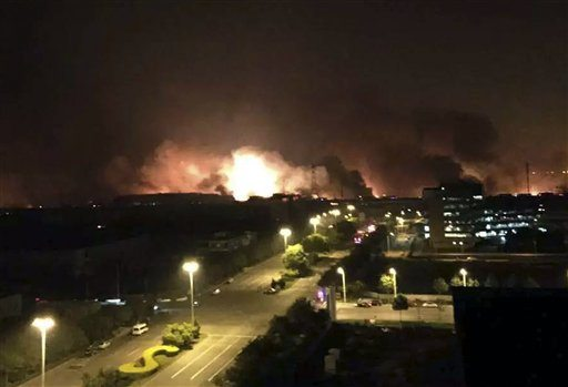 In this photo released by Xinhua News Agency smoke and fire erupt into the night sky after an explosion in the Binhai New Area in north China's Tianjin Municipality on Thursday Aug. 13, 2015. (Yue Yuewei/Xinhua via AP)