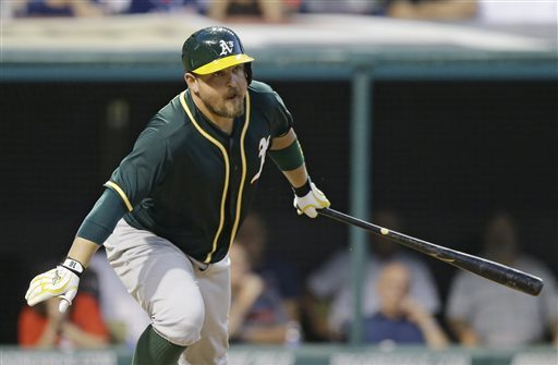 Oakland Athletics' Billy Butler watches after hitting a two-RBI double off Cleveland Indians relief pitcher Bryan Shaw in the eighth inning of a baseball game Saturday. (AP Photo/Tony Dejak)