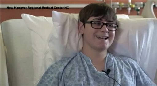 """In this image taken from video provided by New Hanover Regional Medical Center, 16-year-old Hunter Treschl, of Colorado Springs, Colo., speaks during an interview at New Hanover Regional Medical Center in Wilmington, N.C., Tuesday, June 16, 2015. The teen was seriously wounded in a shark attack. """"We were just playing around in the waves, and I felt a hit on my left calf,"""" Treschl said in a videotaped interview released Tuesday night by the hospital where he is being treated. """"I thought it felt like a big fish, and I started moving away. And then the shark bit my arm _ off.""""  (New Hanover Regional Medical Center via AP)"""