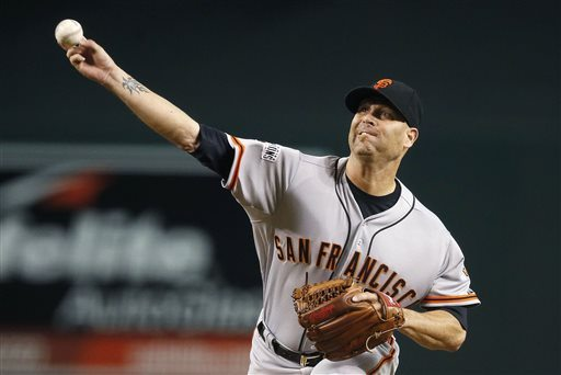 San Francisco Giants' Tim Hudson throws a pitch against the Arizona Diamondbacks during the first inning Tuesday. (AP Photo/Ross D. Franklin)