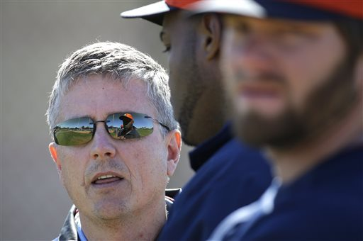 FILE - In this Feb. 18, 2013, file photo, Houston Astros general manager Jeff Luhnow, left, talks with players during a spring training baseball workout in Kissimmee, Fla. The analytical approach helped the St. Louis Cardinals with the World Series in 2011 and is starting to pay off for the first-place Houston Astros. And now the work of former baseball outsider Jeff Luhnow is at the center of a federal probe, with the FBI investigating members of his old team for stealing fresh secrets from a man who left for Houston after clashing with some old-school idealists in St. Louis.  (AP Photo/David J. Phillip, File)