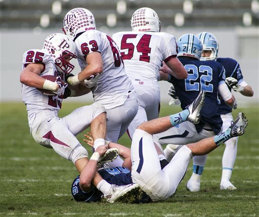 Ringo H.W. Chiu/APSacred Heart Prep's Ben Burr-Kirven (25) is tackled by Corona del Mar's Parker Chase