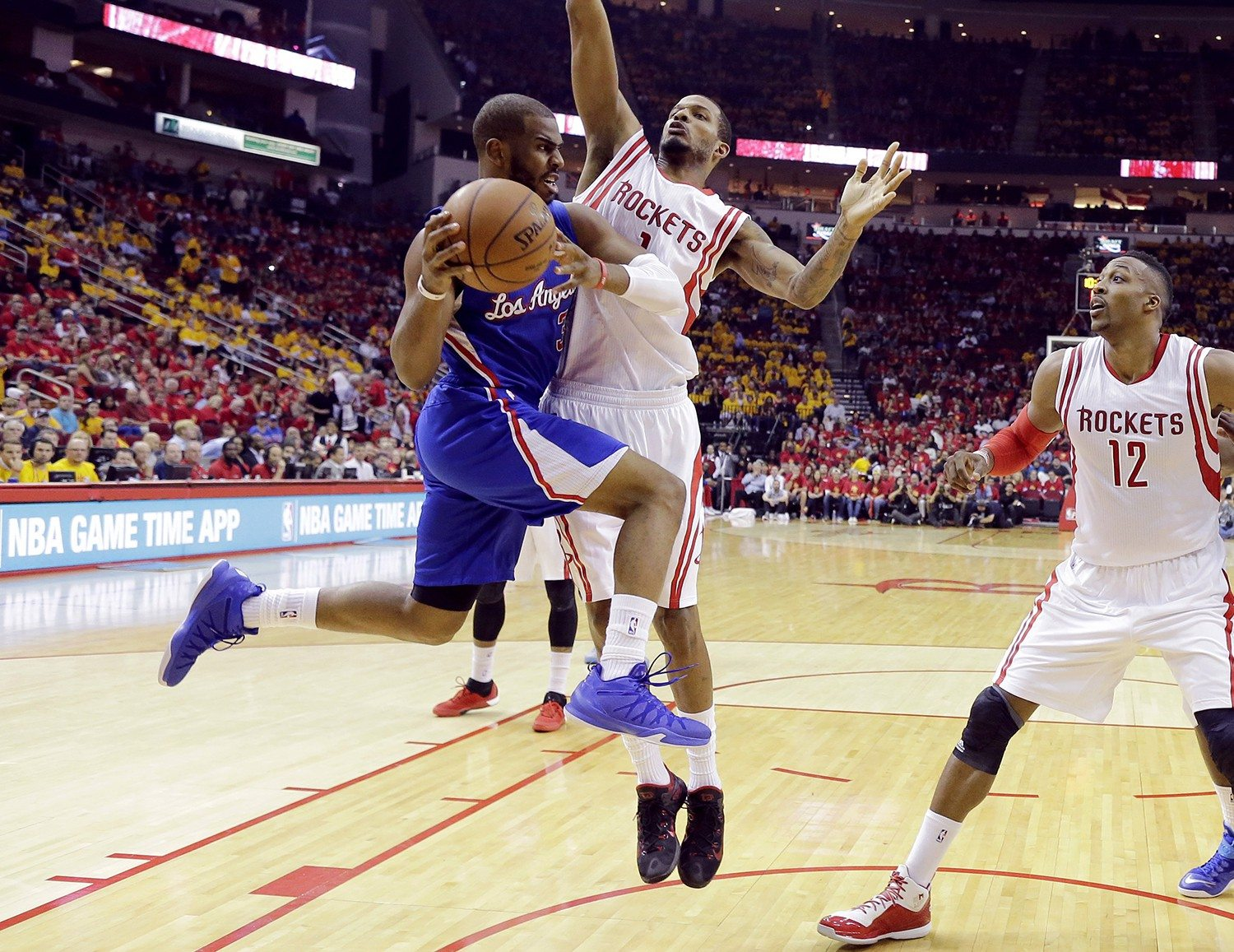 David J. Phillip/APLos Angeles Clippers' Chris Paul (3) drives around Houston Rockets' Trevor Ariza (1) and Dwight Howard (12) during the Game 5 of the NBA Western Conference semifinals Tuesday.