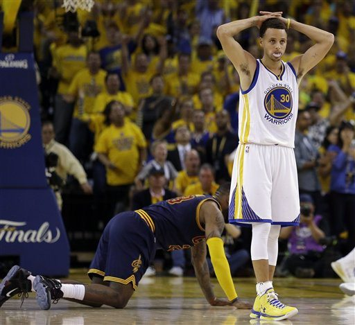AP Photo/Ben MargotGolden State Warriors guard Stephen Curry (30) reacts after being called for a foul on Cleveland Cavaliers forward LeBron James