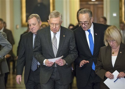 Senate Minority Leader Harry Reid of Nev., second from left, accompanied by, from left, Senate Minority Whip Richard Durbin of Ill., Sen. Charles Schumer, D-N.Y., and Sen. Patty Murray, D-Wash., walk from a closed-door Democratic caucus lunch, on Capitol Hill in Washington on Tuesday. (AP Photo/J. Scott Applewhite)