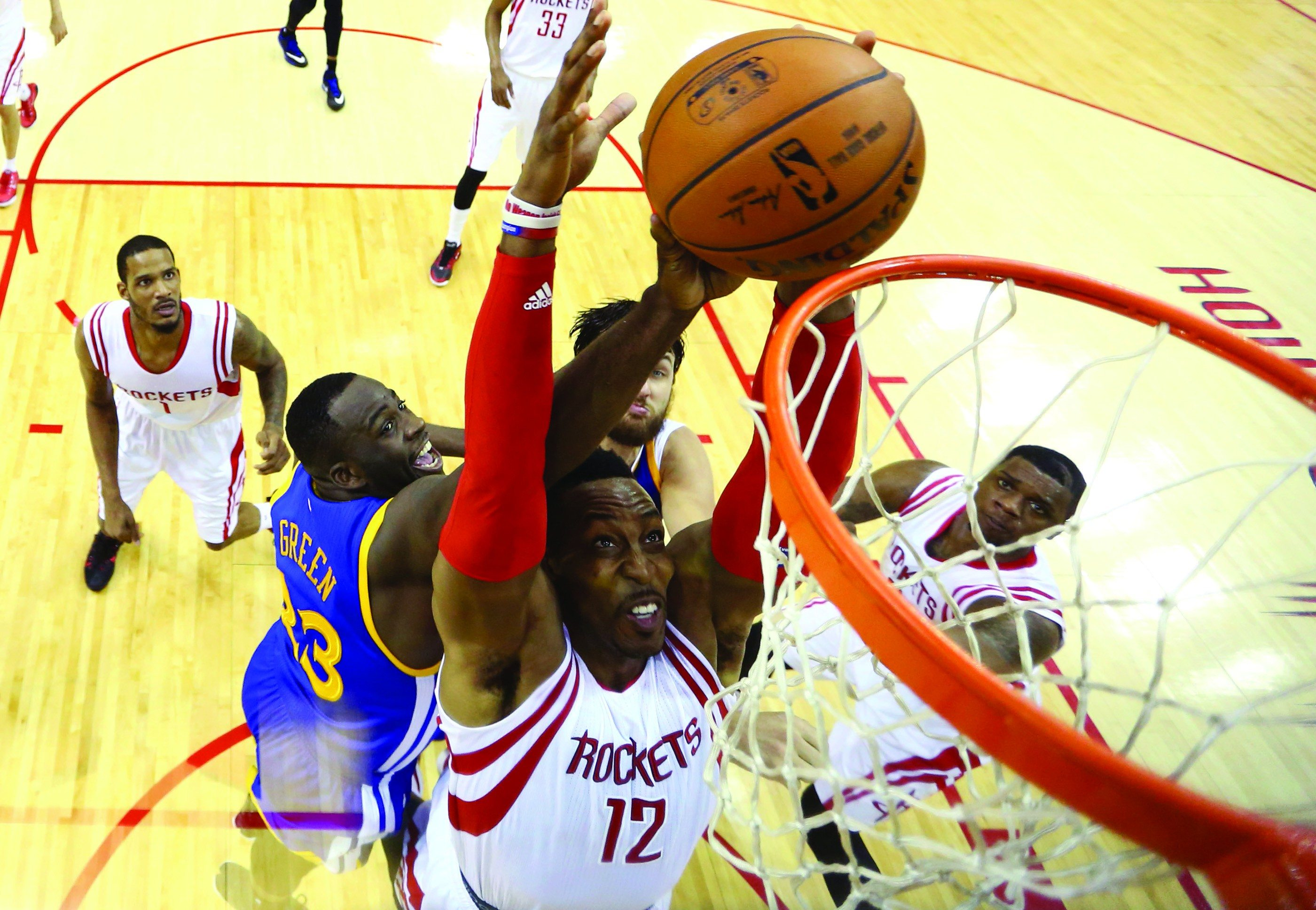 Ronald Martinez/APThe physical play of Houston Rockets center Dwight Howard (12) has presented some trouble for the Warriors