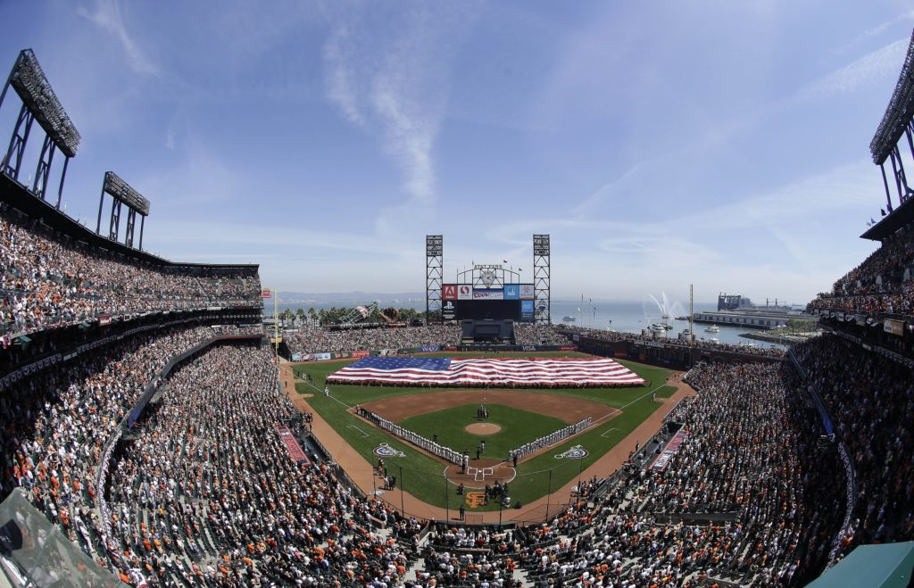 AP Photo/Jeff ChiuA large flag is presented in the AT&T Park outfield during the national anthem before an opening day baseball game between the San Francisco Giants and the Arizona Diamondbacks in San Francisco