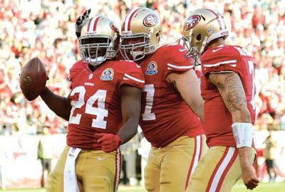 Thearon W. Henderson/Getty ImagesAnthony Dixon (24) celebrates with Niners teammates Daniel Kilgore