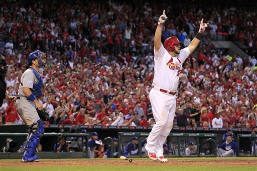 Jeff Roberson/APCardinals slugger Matt Adams celebrates hitting a three-run home run against the Dodgers in the seventh inning of Game 4 in the NL Division Series. The Cardinals won