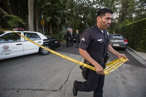 AP Photo/Ringo H.W. ChiuA police officer creates a perimeter outside a home in the Hollywood Hills area of Los Angeles