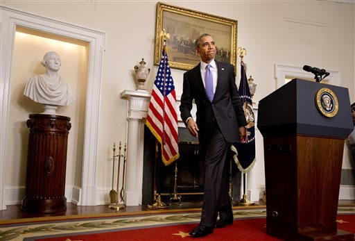 President Barack Obama leaves the podium after speaking about the release of Americans by Iran on Sunday in the Cabinet Room of the White House in Washington. (AP Photo/Jacquelyn Martin)