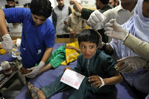Pakistani doctors treat patients at a hospital after an earthquake hit, in Peshawar, Pakistan on Monday. (AP Photo/Mohammad Sajjad)