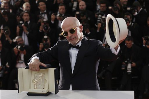 AP Photo/Thibault CamusDirector Jacques Audiard holds the Palme d'Or award for the film Dheepan as he poses for photographers during a photo call following the awards ceremony at the 68th international film festival