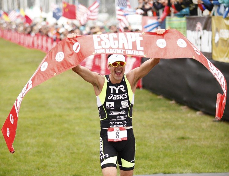 Juan Pardo/Special to The S.F. ExaminerAndy Potts celebrates after winning the Escape from Alcatraz Triathlon on Sunday.