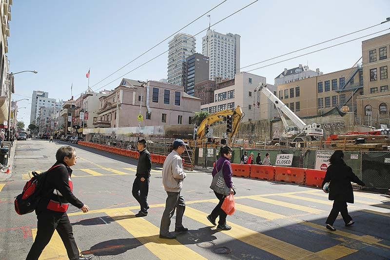 City officials have sketched out a plan to improve pedestrian safety in Chinatown. (AP Photo/Eric Risberg)