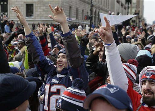 Steven Senne/Ap PhotoNew England Patriots fans cheer as the team passes by in a procession of duck boats during a parade in Boston Wednesday