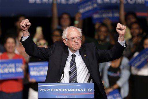 Democratic presidential candidate, Sen. Bernie Sanders, I-Vt. acknowledges his supporters on arrival at a campaign rally, Tuesday in Miami. (AP Photo/Alan Diaz)