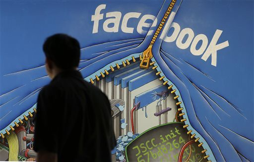 Jeff Chiu/ap file photoA man who posted threats on Facebook against a former Ferguson police officer has been ordered to stay off social media.