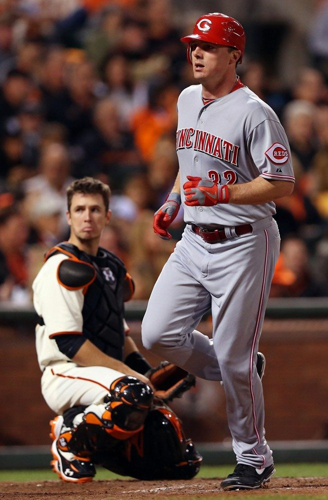 Jeff Gross/Getty ImagesOver the alley: Reds slugger Jay Bruce trots past Giants catcher Buster Posey after drilling a solo home run to the deepest part of AT&T Park