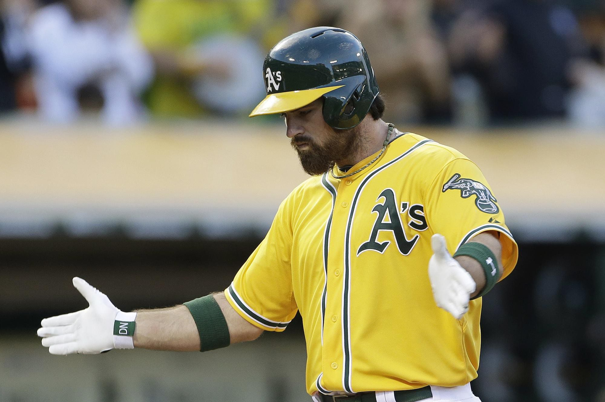 Associated PressOakland Athletics' Derek Norris reacts after hitting a two-run home run off San Francisco Giants starting pitcher Michael Kickham during the second inning of a baseball game Tuesday