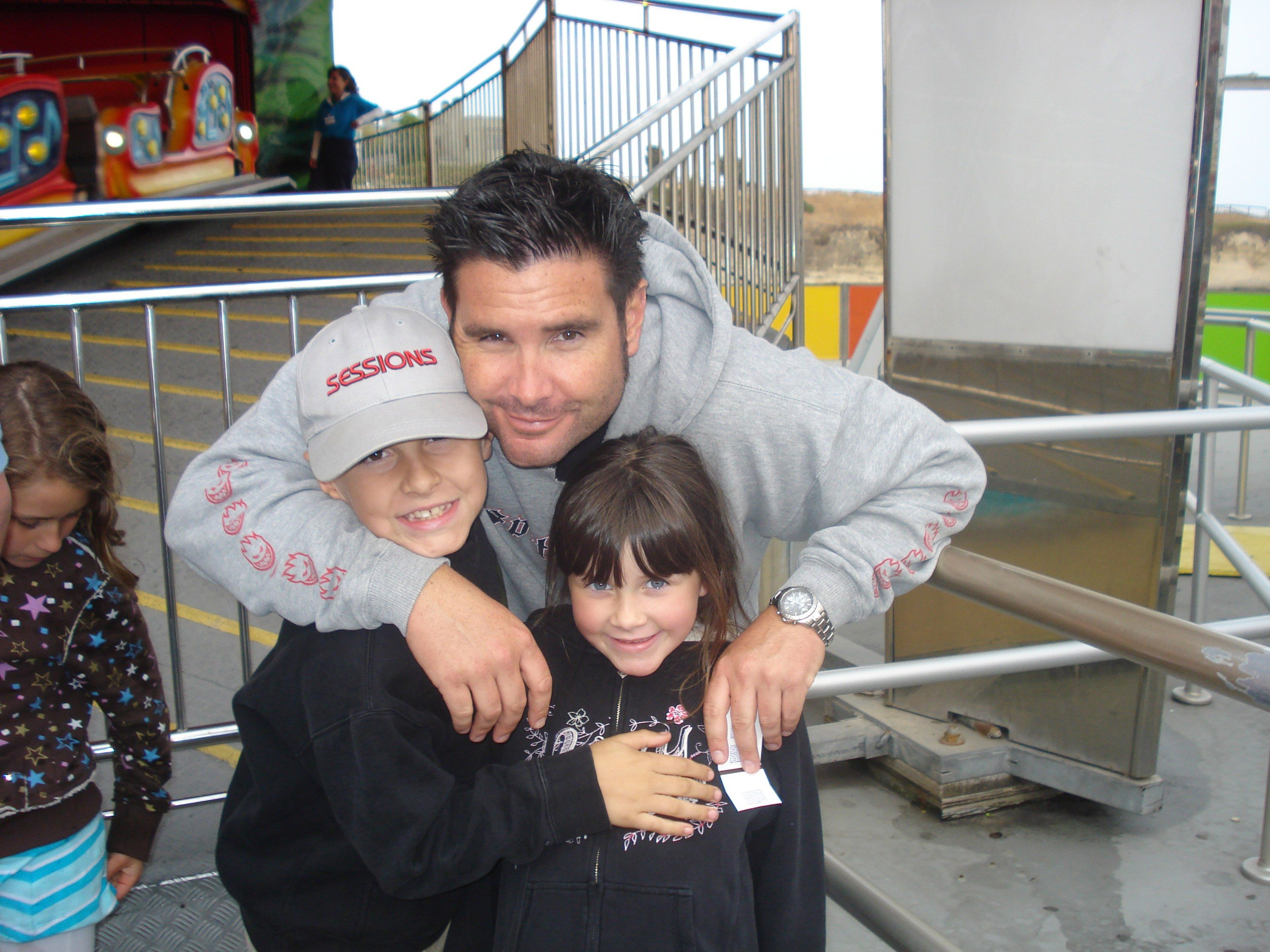 AP Photo/John StowThis undated image shows Bryan Stow holding his 12-year-old son and 8-year-old daughter.