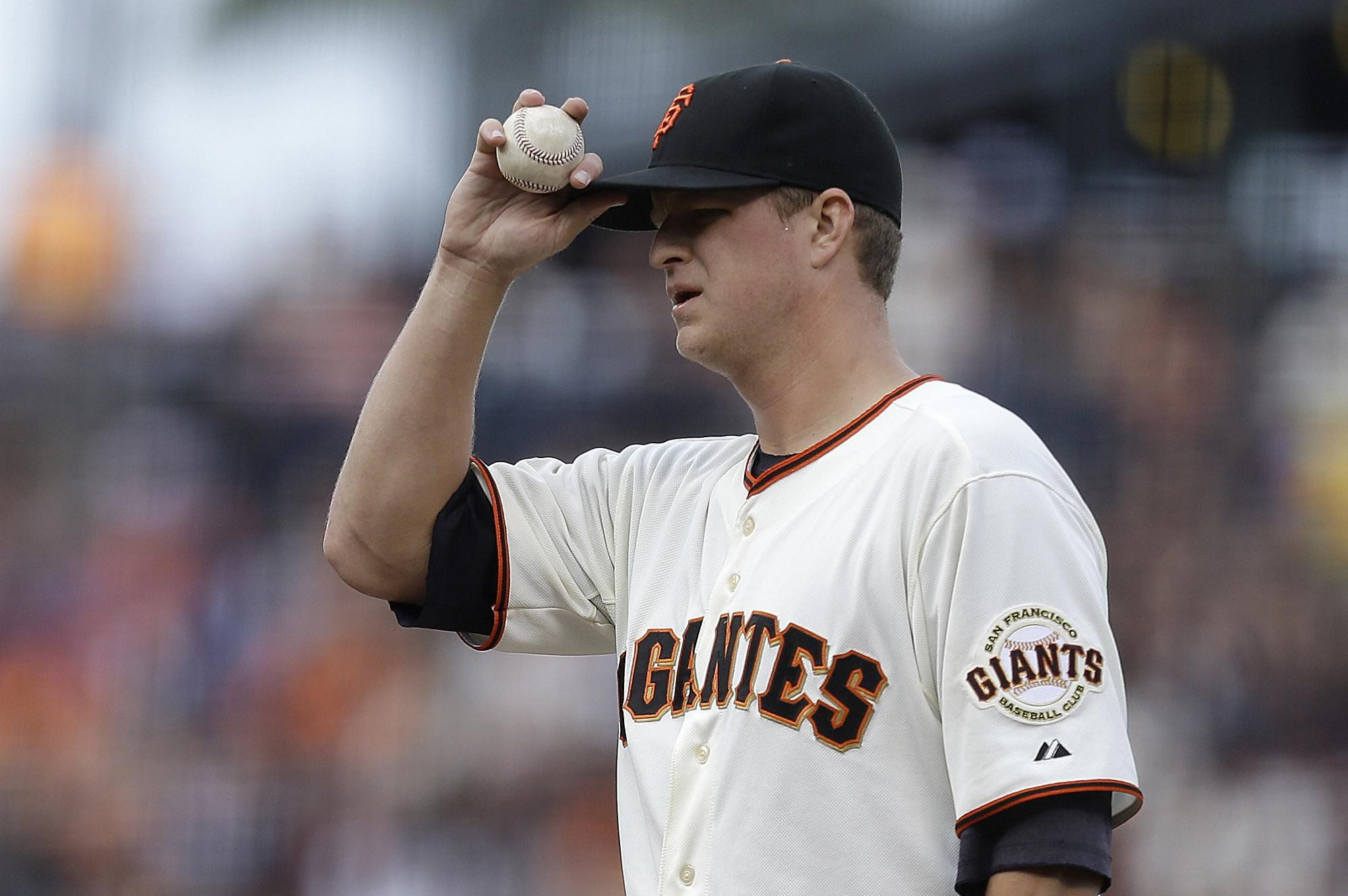 Associated PressSan Francisco Giants' Matt Cain adjusts his cap in the first inning of a baseball game against the Los Angeles Dodgers
