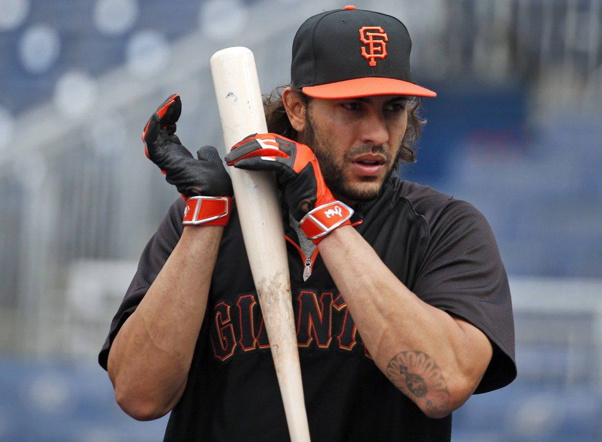 AP Photo/Alex BrandonSan Francisco Giants' Michael Morse listens as he taps his bat during an MLB baseball workout at Nationals Park
