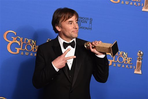 """Jordan Strauss/Invision via APRichard Linklater poses with the best director award for """"Boyhood"""" at the Golden Globe Awards on Sunday."""