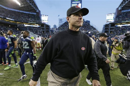 John Froschauer/AP PhotoSan Francisco 49ers head coach Jim Harbaugh walks off the field at the end of an NFL football game against the Seattle Seahawks