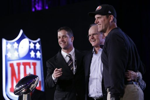 AP Photo/Patrick SemanskySan Francisco 49ers head coach Jim Harbaugh and Baltimore Ravens head coach John Harbaugh pose with their father Jack Harbaugh at a news conference for the NFL Super Bowl XLVII football game Friday