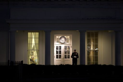AP Photo/Jacquelyn MartinA Marine stands guards outside the West Wing of the White House in Washington
