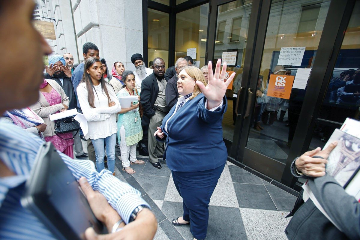 Mike Koozmin/The S.f. Examiner File photoA worker addresses travelers angry about Cox & Kings' backlog of Indian visas at the company's Bush Street Office