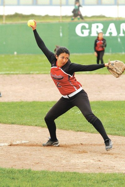 Willie Eashman/Special to The S.F. ExaminerLowell senior Michelle Willis delivered in the circle and at the plate during a victory against Lincoln in the AAA opener Monday.