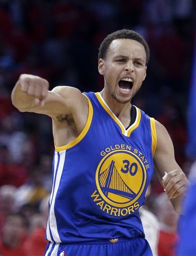 Gerald Herbert/APThe Warriors' Stephen Curry celebrates his tying 3-pointer in the final seconds of regulation Thursday. Curry scored 40 points as the Warriors grabbed a 3-0 series lead.