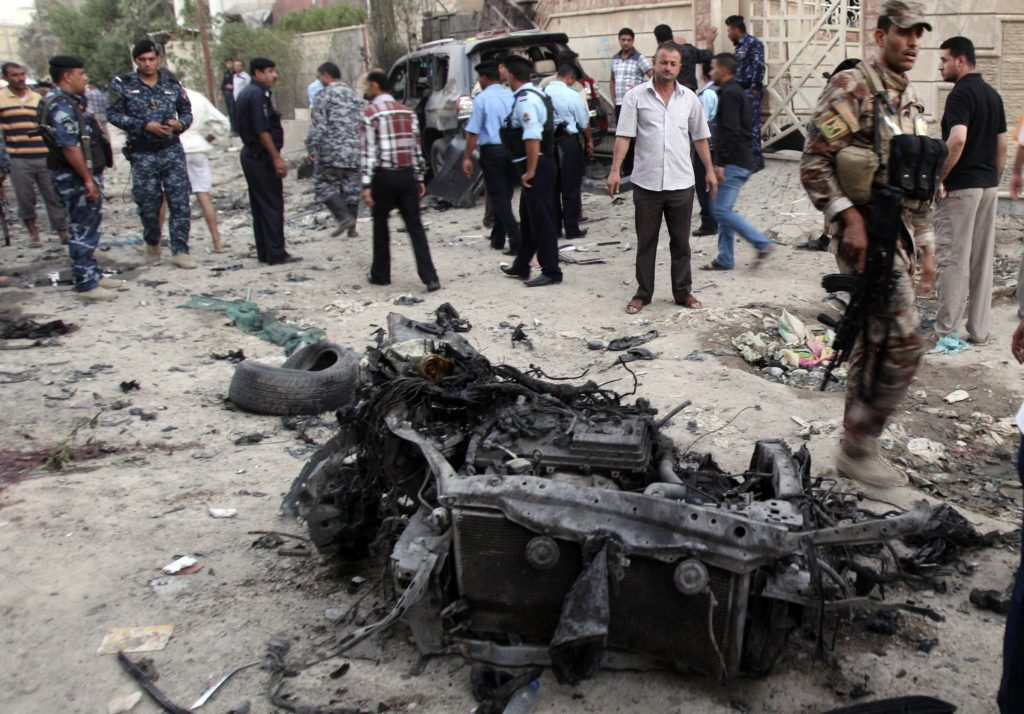 AP Photo/ Nabil al-JuraniSecurity forces inspect the scene of a car bomb attack in Basra