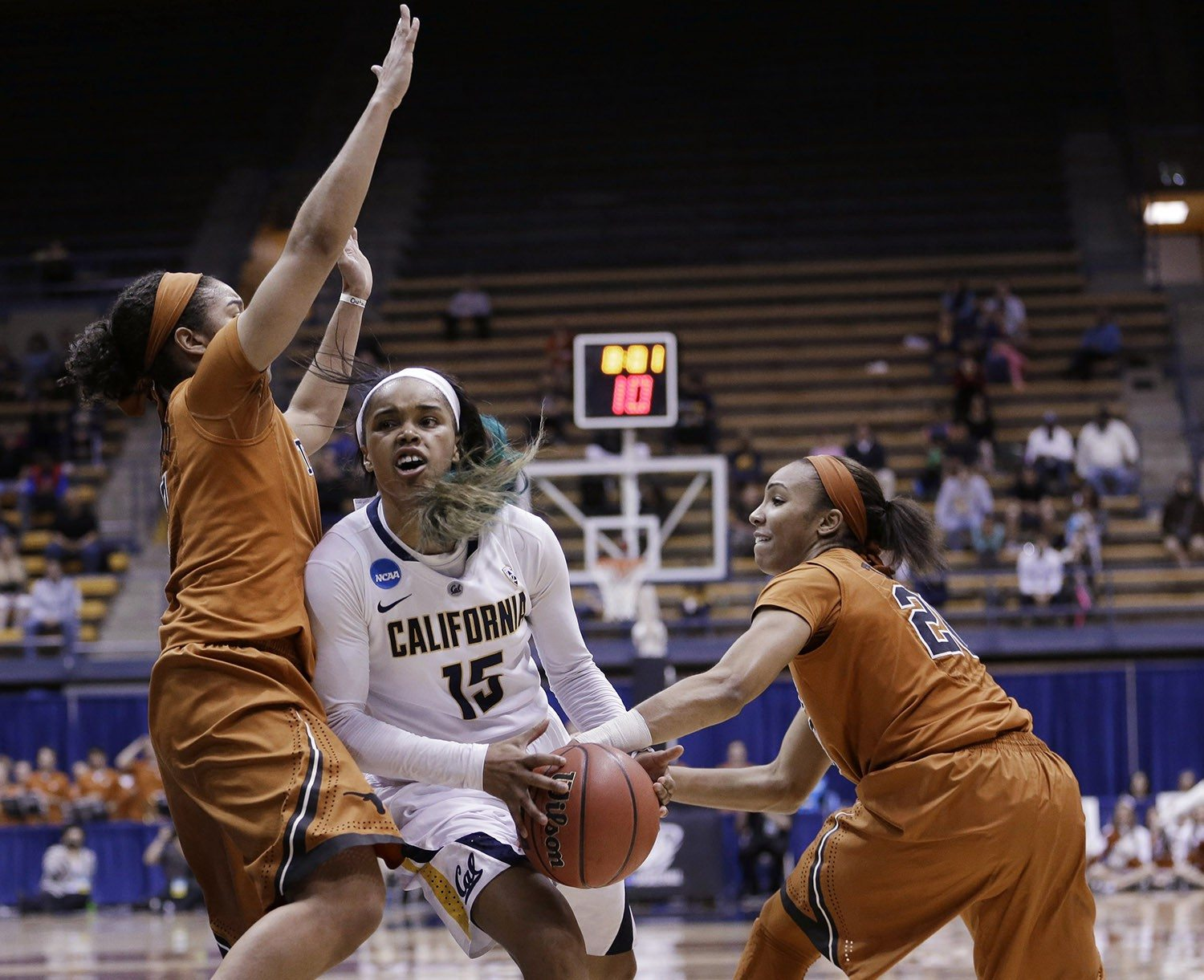 Marcio Jose Sanchez/APCalifornia guard Brittany Boyd (15) tries to get a shot off between Texas guards Celina Rodrigo