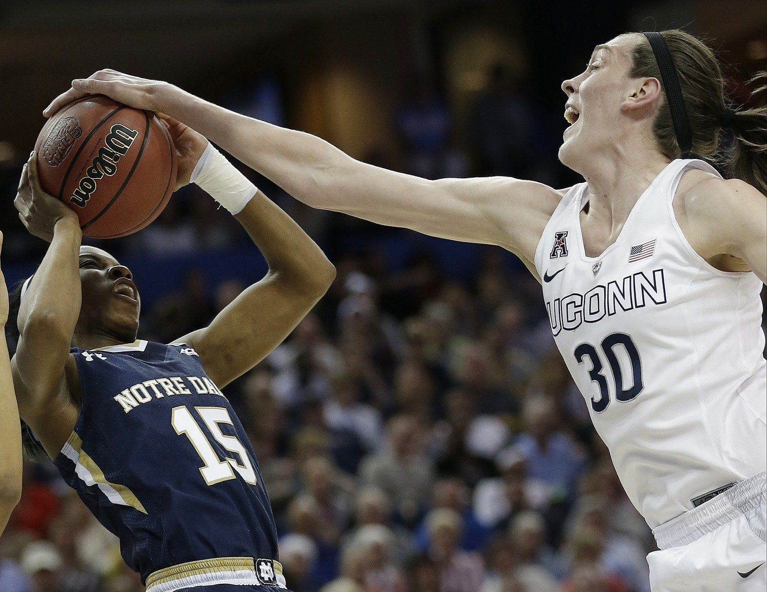 John Raoux/APNotre Dame guard Lindsay Allen (15) is stopped by Connecticut forward Breanna Stewart (30) during Tuesday's NCAA women's basketball championship game.