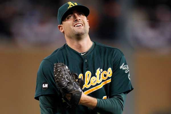Getty Images File PhotoRight-handed reliever Pat Neshek signed a one-year contract with the A's.