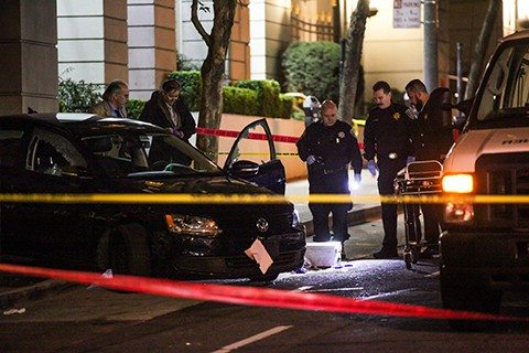 Gabrielle Lurie/Special to The S.F. ExaminerPolice investigate the vehicle a woman was shot and killed in during an officer-involved shooting.