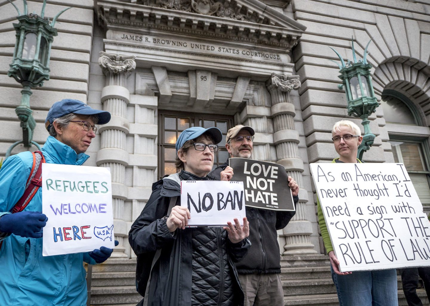 Protesters stand outside the 9th U.S. Circuit Court of Appeals in San Francisco on Feb. 7 while the court hears arguments regarding President Donald Trump's travel ban. (Courtesy agenzia32.com/Shutterstock)