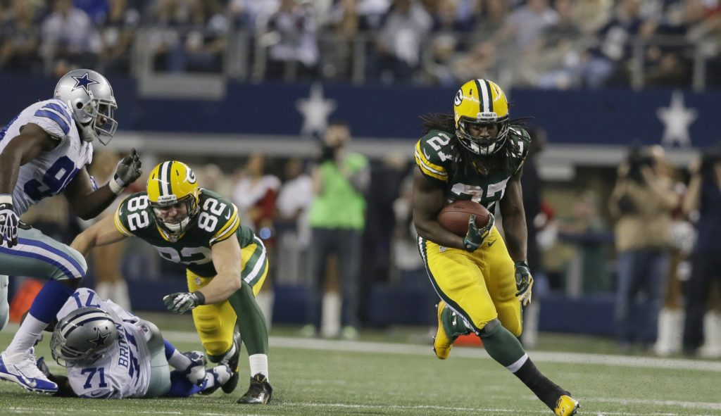AP Photo/Tony GutierrezGreen Bay Packers running back Eddie Lacy (27) finds open field as teammate Green Bay Packers tight end Ryan Taylor (82) blocks Dallas Cowboys defensive ends Everette Brown (71) and George Selvie (99) during the second half of an NFL football game Sunday