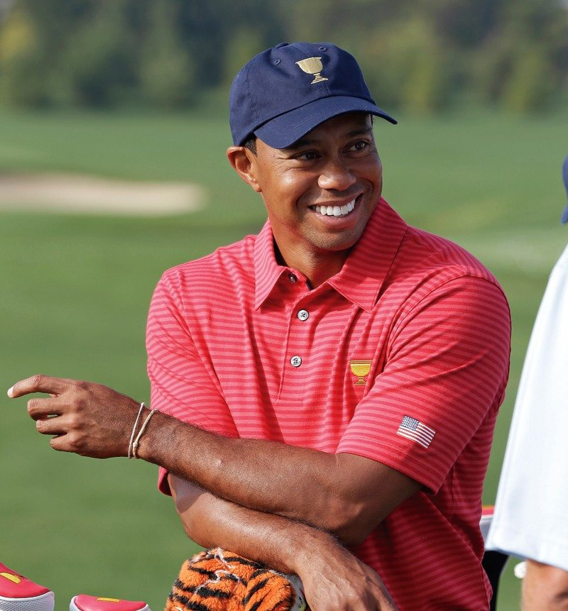 Darron Cummings/APTiger Woods waits for a team photo for the Presidents Cup golf tournament at Muirfield Village Golf Club on Wednesday. He was paired with Matt Kuchar for today's opening fourballs.