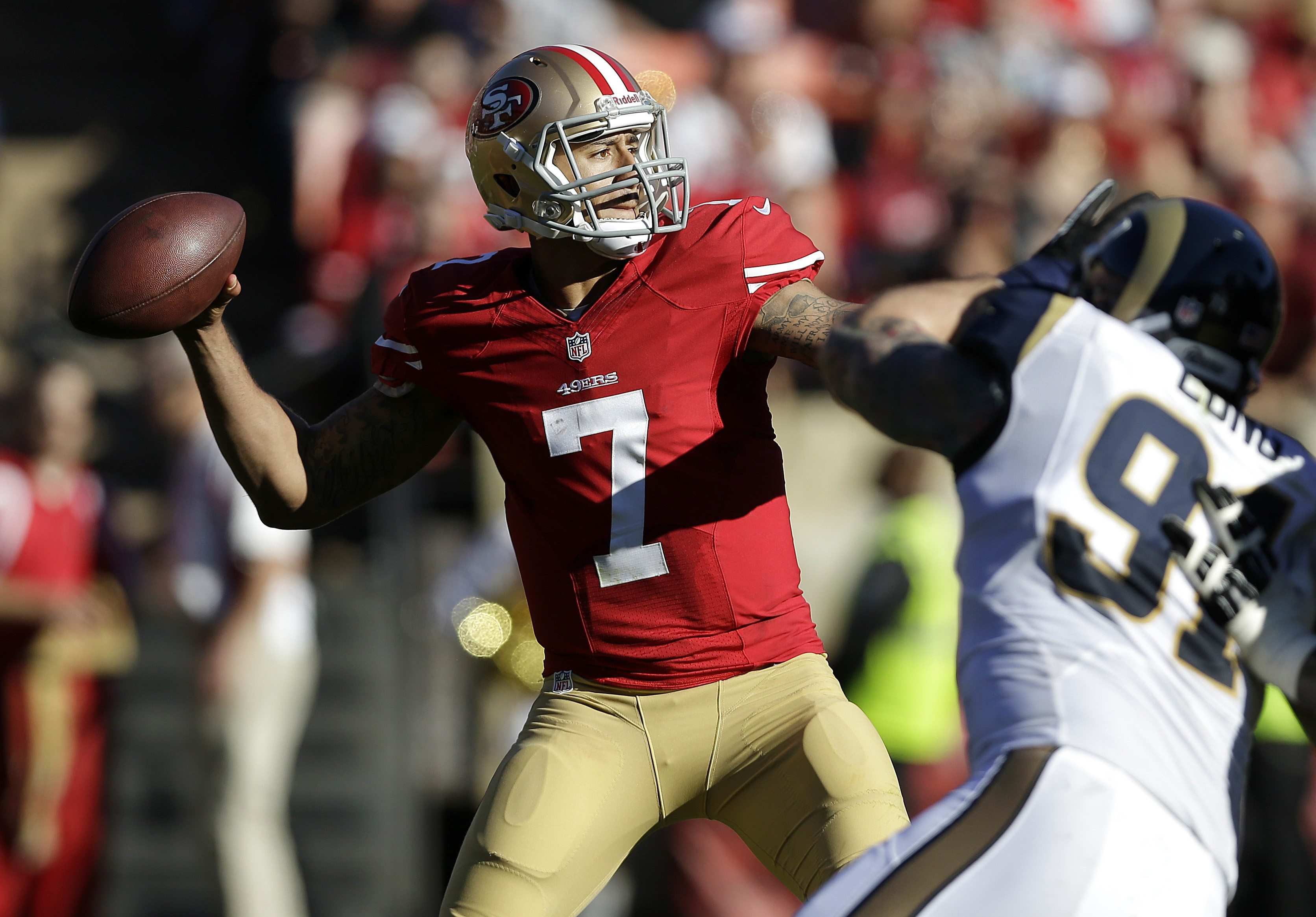 AP Photo/Marcio Jose SanchezSan Francisco 49ers quarterback Colin Kaepernick (7) passes as St. Louis Rams defensive end Chris Long (91) applies pressure during the second quarter of an NFL football game in San Francisco