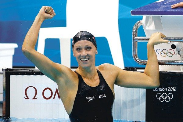 Jamie Squire/Getty ImagesDana Vollmer of the United States celebrates after winning the gold medal and setting a new world record time of 55.98 seconds in the Women's 100m Butterfly final on Day 2 of the London 2012 Olympic Games at the Aquatics Centre.