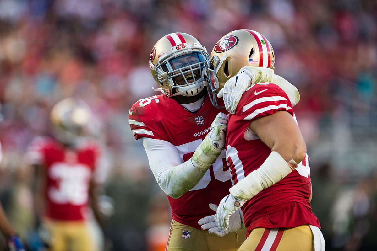 San Francisco 49ers outside linebacker Reuben Foster, left, celebrates with middle linebacker Brock Coyle  after making a defensive stop against the New York Giants at Levi's Stadium on Nov. 12, 2017. (Stan Olszewski/Special to S.F. Examiner)