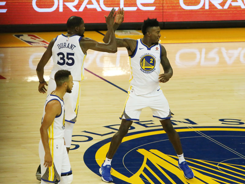 Jordan Bell completes a putback slam for the Golden State Warriors during the preseason. He is one of the players likely to participate in summer league action at the California Classic. (Mira Laing/Special to S.F. Examiner)