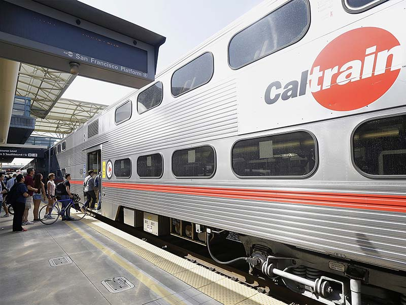 Caltrain will implement a 50 cent increase on adult fares and daily parking fees beginning Feb. 28, 2016. (AP Photo/Jeff Chiu)