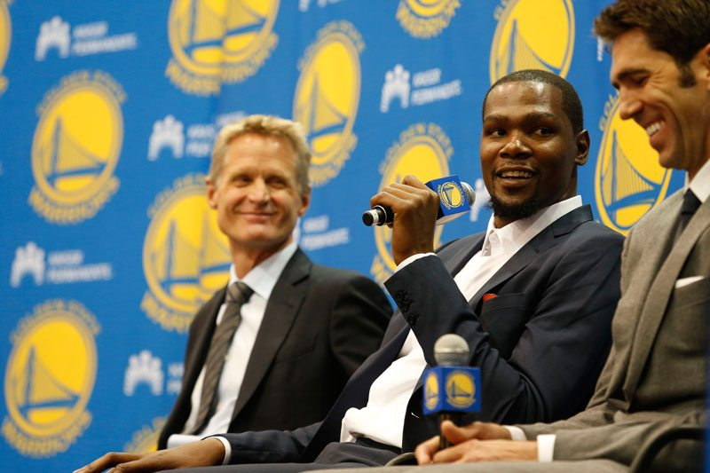 Kevin Durant, center, speaks as coach Steve Kerr, left and general manager Bob Myers listen during a news conference at the Warriors' practice facility in Oakland. (Beck Diefenbach/AP)