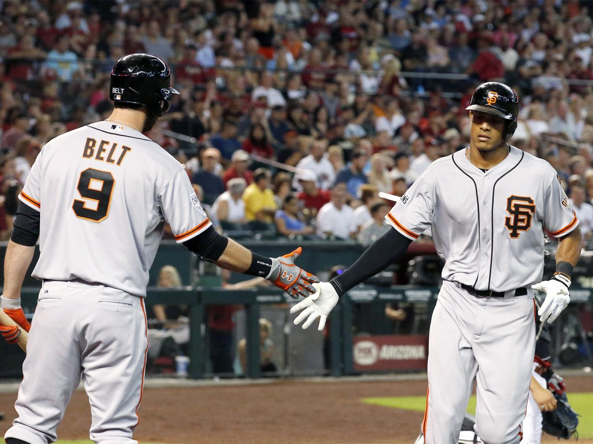 The Giants' Justin Maxwell, right, slaps hands with Brandon Belt after hitting a home run off the Diamondbacks' Patrick Corbin on Sunday, July 19, 2015, in Phoenix. (Ross D. Franklin/AP)